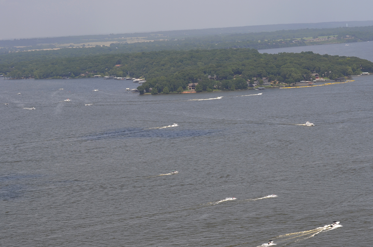 Boats Make Their Way Across The Waters Of Grand Lake On A Summer Day.