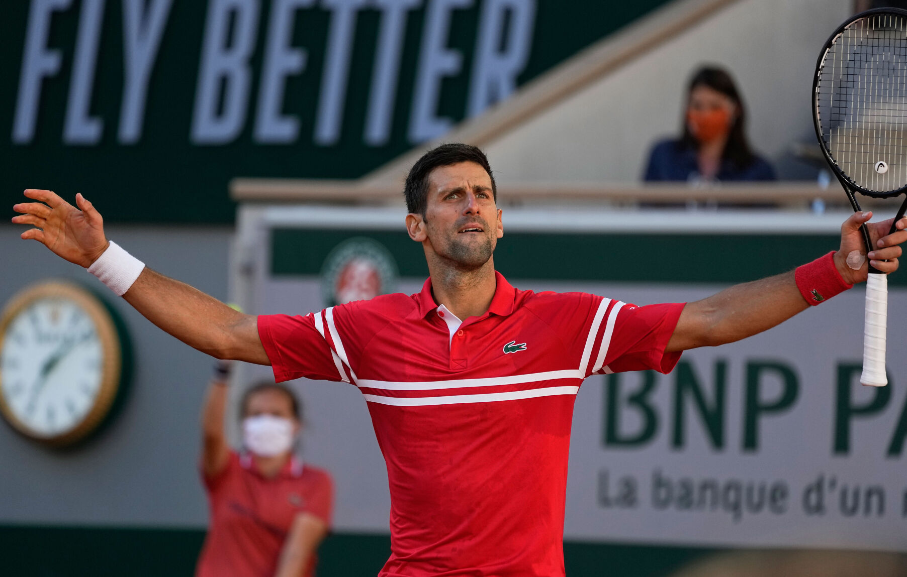 <p>Serbia's Novak Djokovic reacts after winning a point against Stefanos Tsitsipas of Greece in the men's final of the French Open tennis tournament Sunday in Paris.</p>