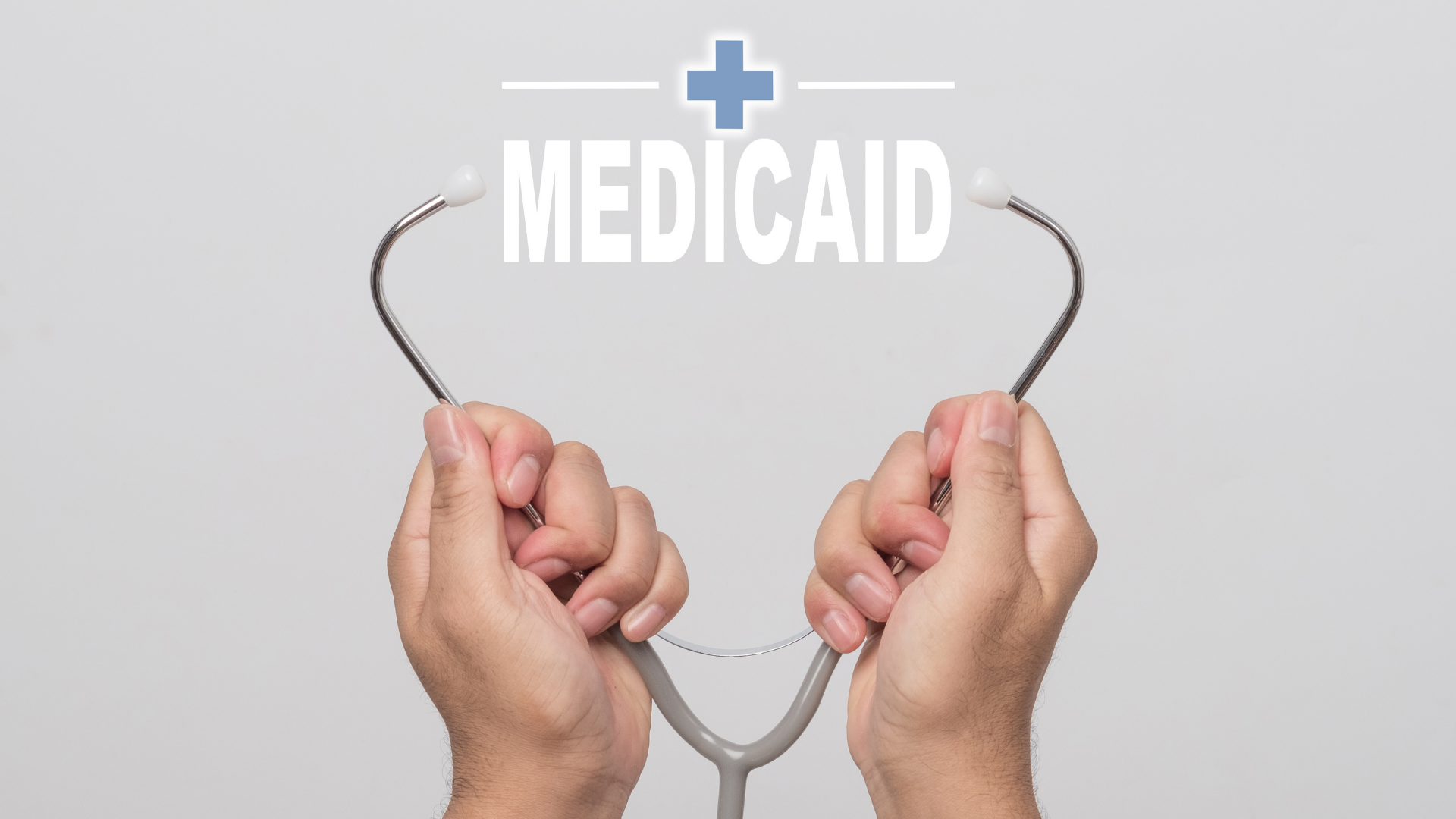 Medicaid Image With Hands And A Stethascope