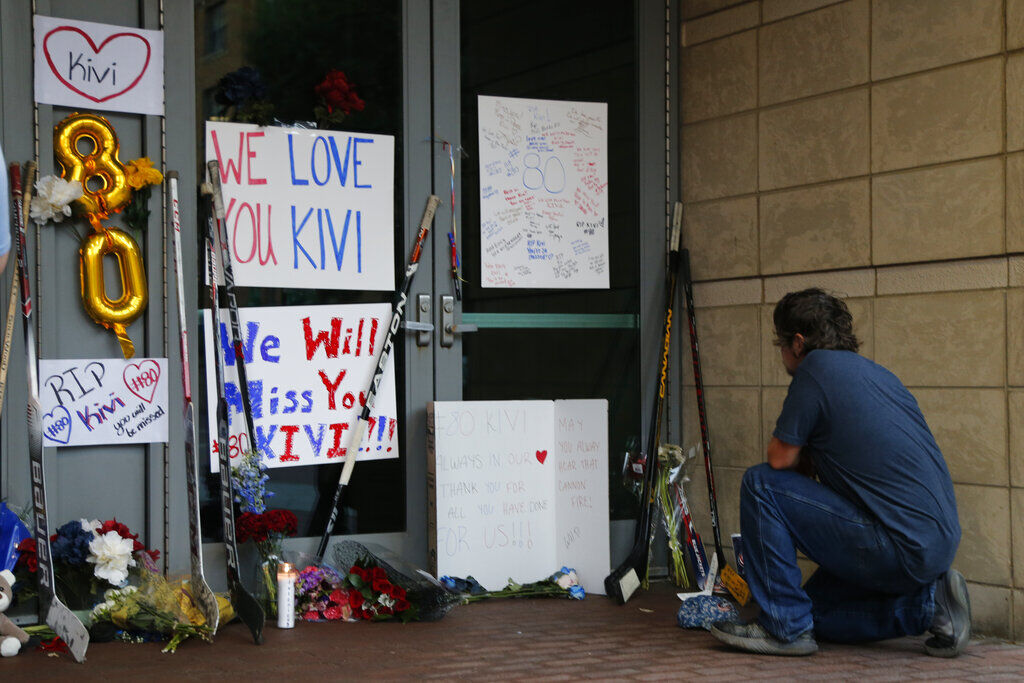<p>Kole Northup visits a makeshift memorial in front of Nationwide Arena Monday, July 5, 2021, in Columbus, Ohio, to remember Columbus Blue Jackets goaltender Matiss Kivlenieks who died of chest trauma from an errant fireworks mortar blast in what authorities described Monday as a tragic accident on the Fourth of July.</p>