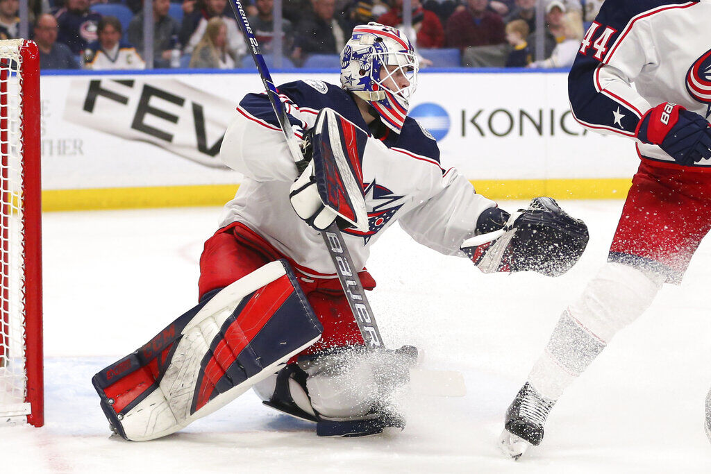 <p>Columbus Blue Jackets goalie Matiss Kivlenieks (80) makes a save during the first period of an NHL hockey game against the Buffalo Sabres in Buffalo, N.Y., in this Saturday, Feb. 1, 2020, file photo.</p>