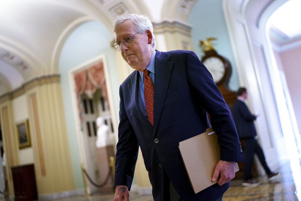 <p>Senate Minority Leader Mitch McConnell, R-Ky., walks to the chamber for a vote on a government spending bill, at the Capitol in Washington, Monday, Sept. 27, 2021.</p>