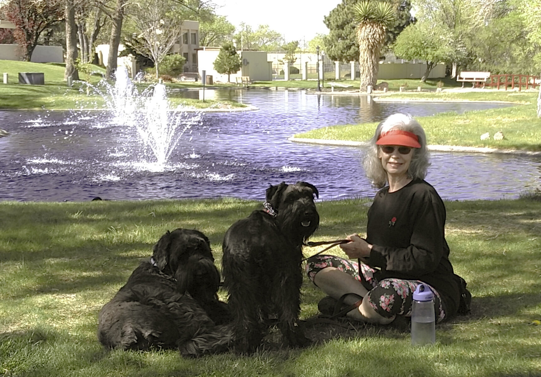 <p>Penny Wagner appears with her two dogs, Clarence, left, and Cooper, in Albuquerque, N.M., on April 8, 2020. Clarence died peacefully March 9 after Wagner and her husband hired a private service that provides home euthanasia for pets.</p>