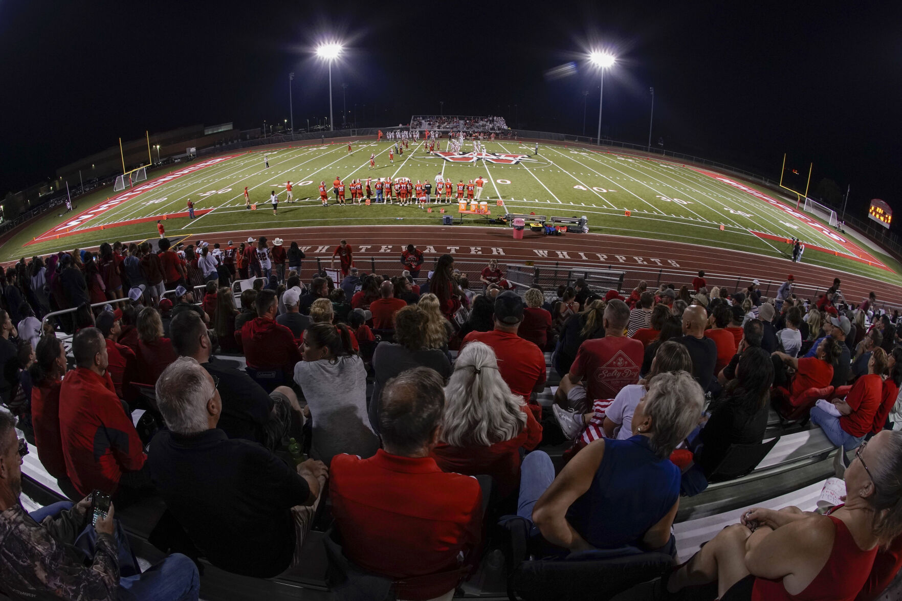 <p>Fans fill the stadium at the football field at Whitewater High School on Friday, Oct. 1, 2021, in Whitewater, Wis. A growing number of school districts in the U.S. are using federal pandemic funding on athletics projects.</p>