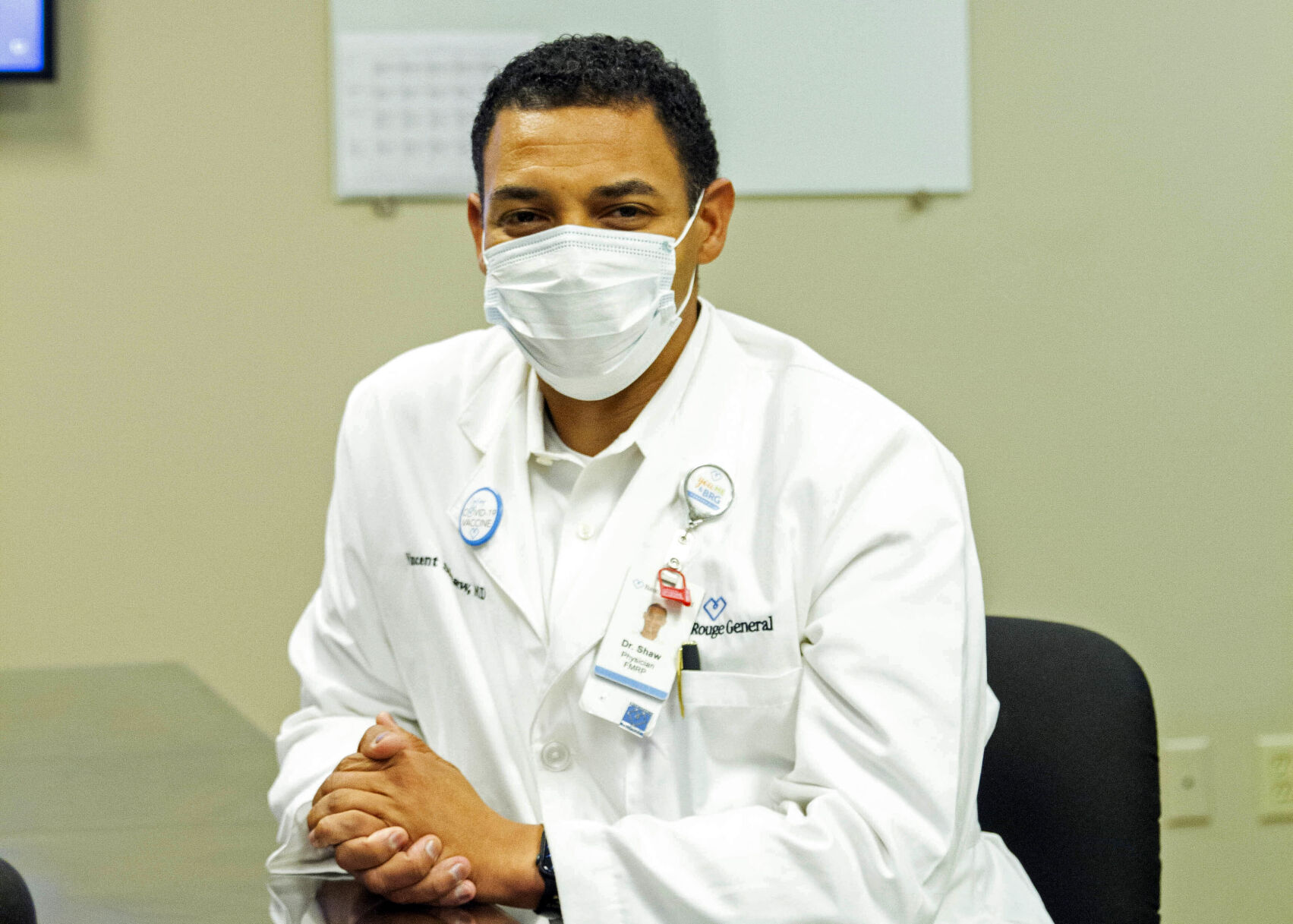 <p>Dr. Vincent Shaw poses for a portrait in Baton Rouge, La., Wednesday, Sept. 29, 2021. He commonly hears patients tell him they haven't done enough research on the COVID-19 vaccines. Rest assured, he tells them, the vaccine developers have done their homework.</p>